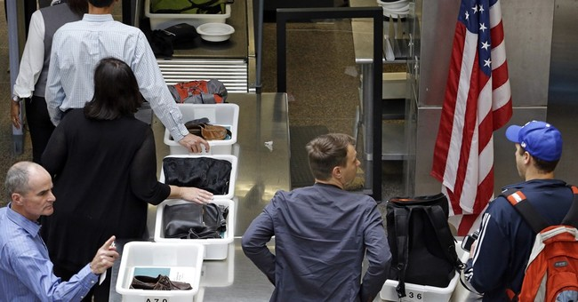Record number of travelers strain Seattle Airport