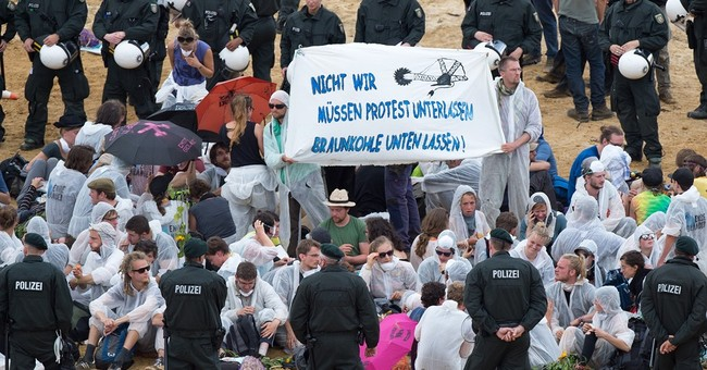 Protesters storm open-pit coal mine in western Germany