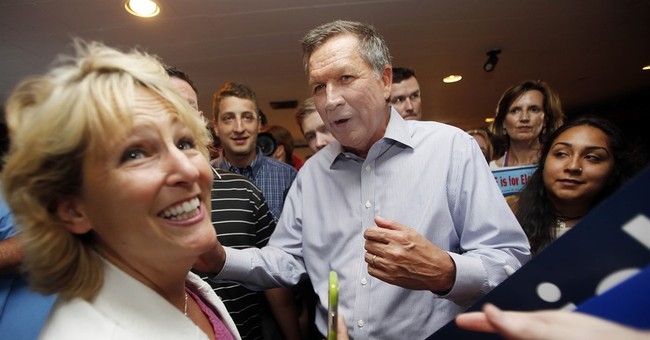 He may be a mystery, but Kasich challenges Bush in NH