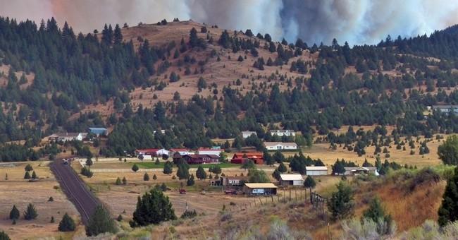 Western wildfires: Wind, heat, dry land fueling large blazes