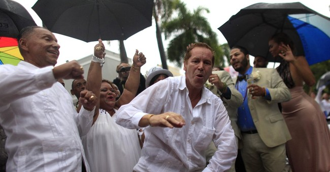 Over 60 same-sex couples married at Puerto Rico wedding
