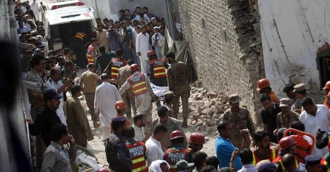 Twin blasts kill anti-Taliban Pakistani minister, 13 more