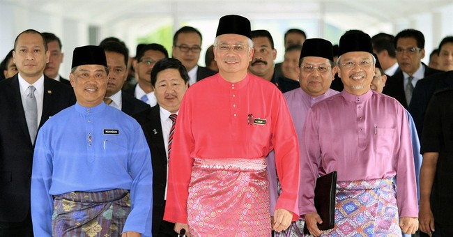 Malaysian leader silences critics, media to survive scandal