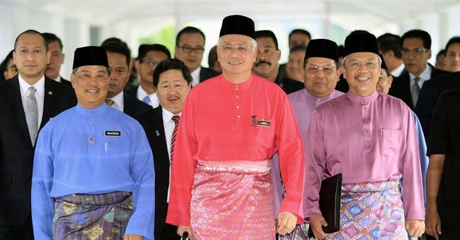 Malaysian leader silences critics, media to survive scandal