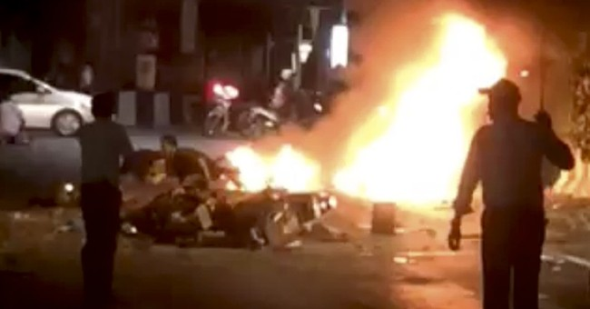 Thai PM vows to quickly find bombers in blast that killed 18