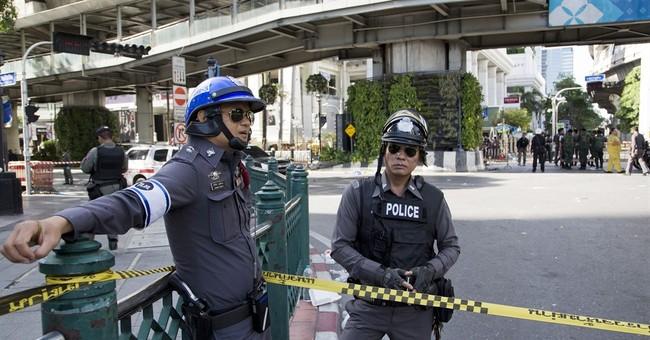 Police hunt 'foreigner' in deadly bombing of Bangkok shrine