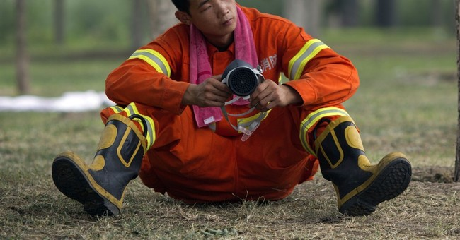 Families of Chinese firefighters seek answers in port blasts