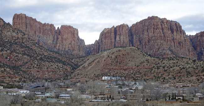 Town once run by polygamist leader is sharply divided