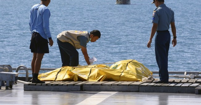 Divers enter crashed AirAsia plane's fuselage for first time