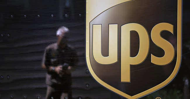 UPS takes a hit during the holidays, cuts outlook
