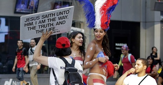 NY governor: Topless women in Times Square breaking the law