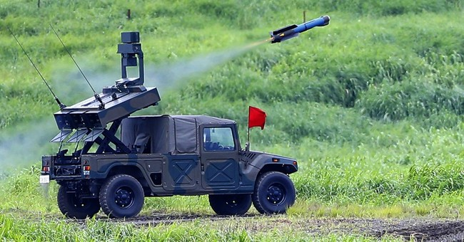 AP PHOTOS: Japan military shows prowess in Mount Fuji drill