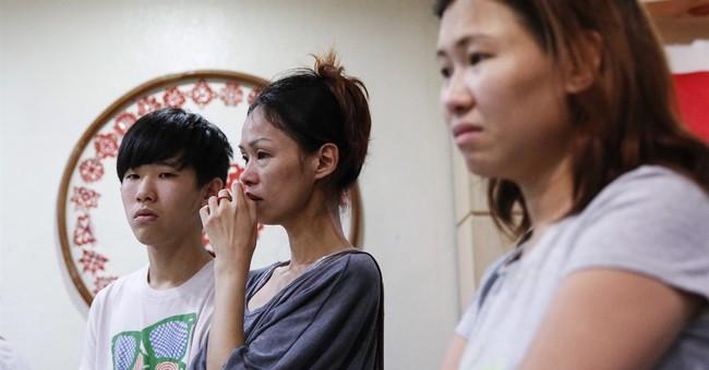 Bangkok attack turns Malaysia family's vacation into tragedy
