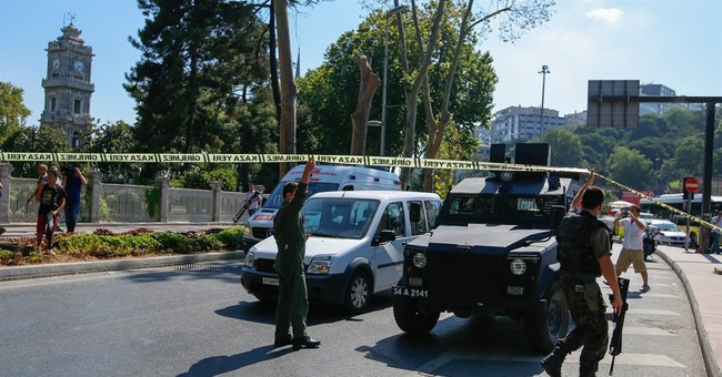 Shots fired at police guarding Istanbul palace; officer hurt