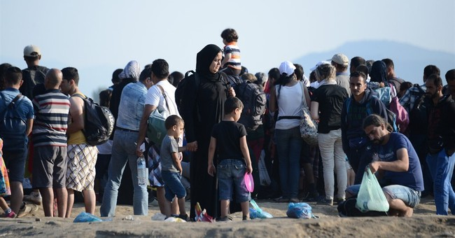 In Greece, red tape, typos add to Syrian refugees' ordeal