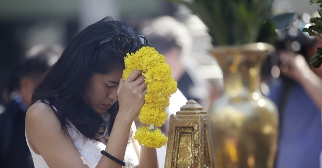 The Latest on Bangkok: Thai police issue arrest warrant