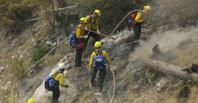 Western wildfires burn unchecked as resources stretched thin