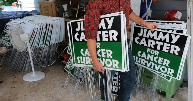 As cancer treatment begins, Carter to scale back on work
