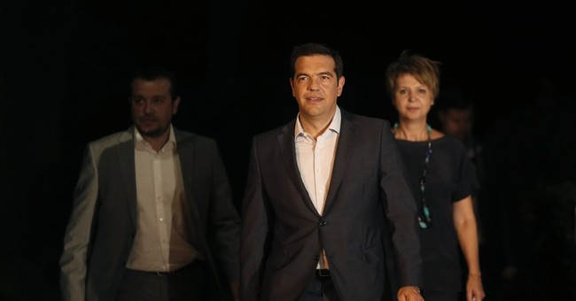 Greek prime minister calls elections after party rebellion