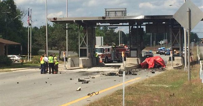 Speeding car slams into tollbooth, catches fire; driver dies