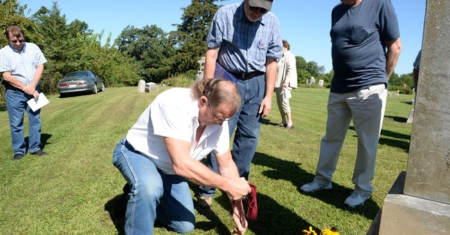Decades after death in Oregon, remains buried in Iowa