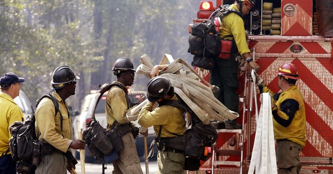 The Latest:  2 vehicles involved in deadly Washington fire