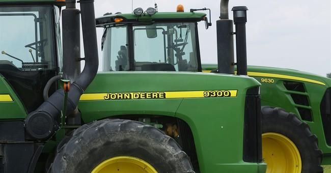 Deere cuts earnings outlook on weak farm, energy sales