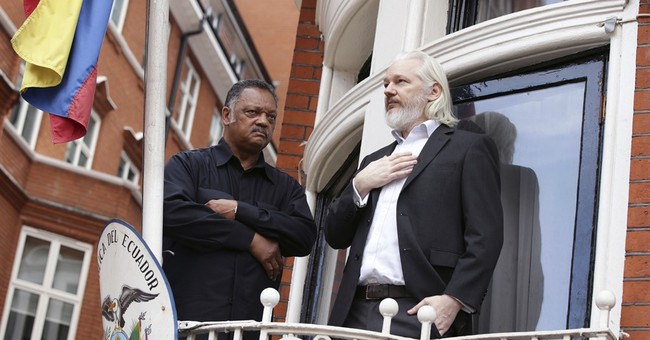 Rev. Jesse Jackson visits Julian Assange in London
