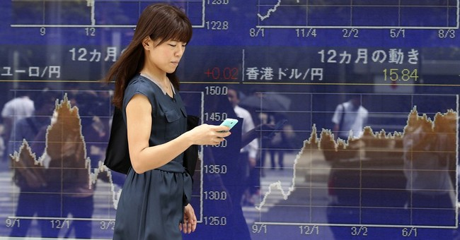 Japan's finance minister warns China on currency moves