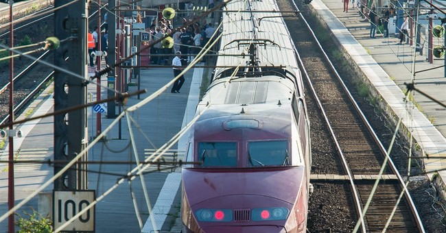 Tragedy averted by train passengers who disarmed gunman