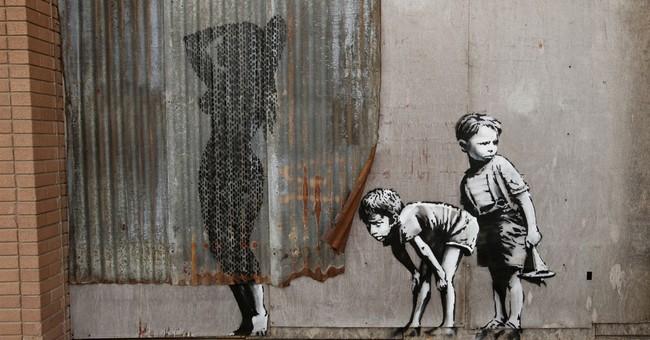 Artist Banksy opens derelict 'Dismaland' theme park