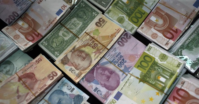 Sinking currencies point to jitters about emerging economies