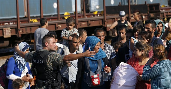 Chaos at Macedonian train station packed with migrants