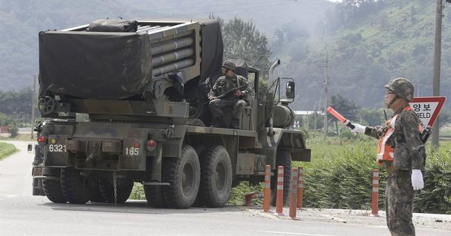 Rival Koreas restart talks, pull back from brink _ for now