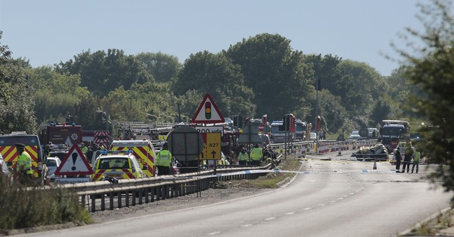 Police say 7 dead after jet in UK airshow crashes into road