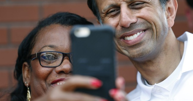 The Latest: Jindal jousts with immigration protesters