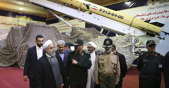Iran unveils new longer-range solid fuel missile