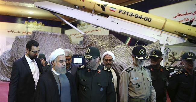 Iran unveils new longer-range solid fuel missile