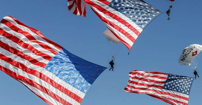 Skydivers parachute into funeral of Army skydiver
