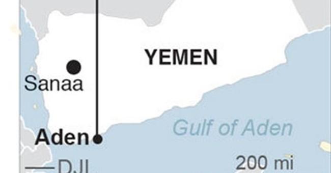 Yemen officials say al-Qaida seizes key areas of Aden