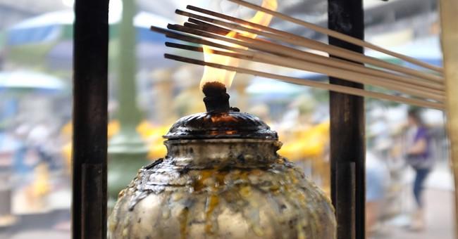 Image of Asia: Lighting incense at Erawan Shrine