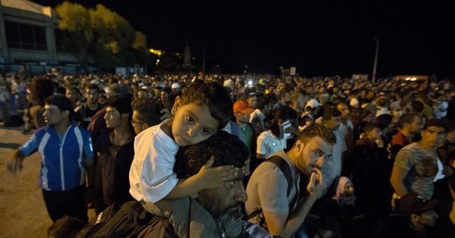 2 refugee boats capsize off Greece, Turkey; 5 dead