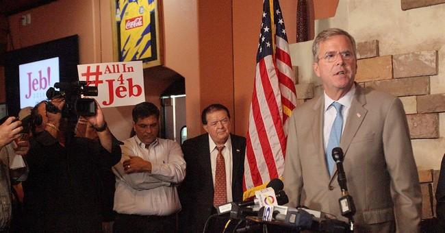 Bush, at Mexican border, denounces Trump's immigration plan