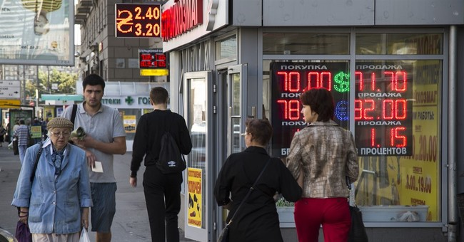 Russian ruble collapses to 7-month low on weak oil prices