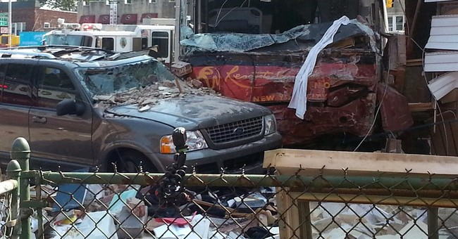 Bus crashes into NYC building, shears off part of it; 6 hurt