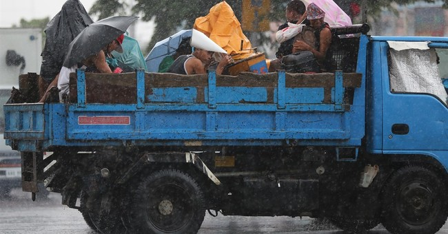 Typhoon Goni damages buildings, drenches western Japan