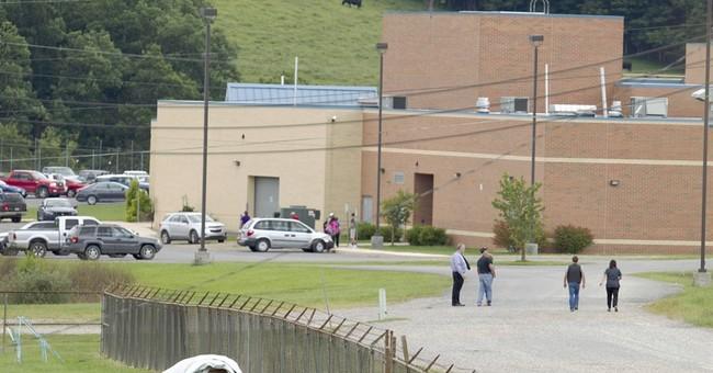 Teacher describes handling gun-wielding teen hostage taker