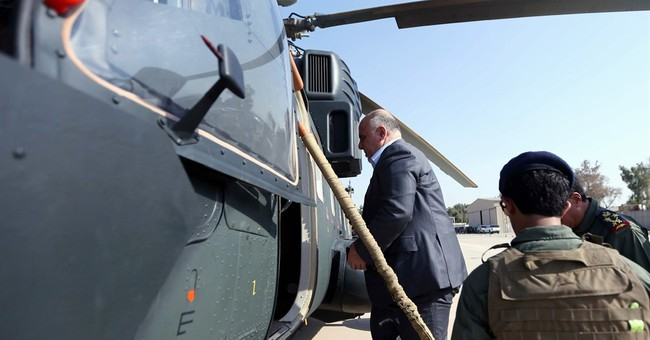 Iraqi PM says defense of refinery town crucial to IS defeat