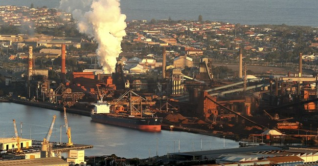 BHP posts 86 percent profit drop as commodity prices tumble