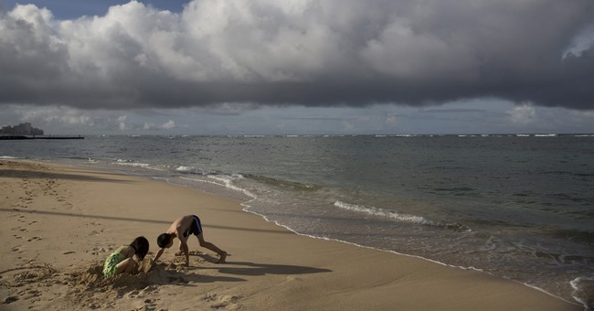 Hawaii officials reopen Waikiki beach after sewage spill